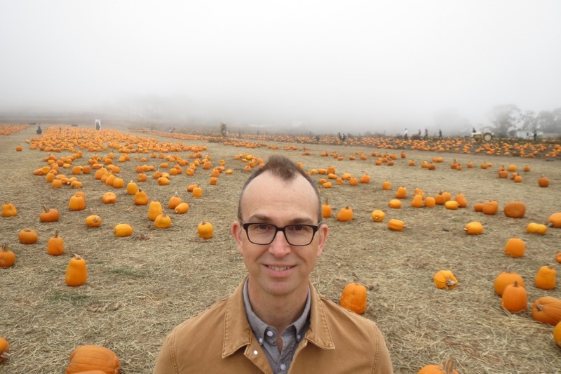 Jamie standing in a pumpkin patch